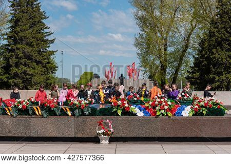 Russia, Irkutsk - May 27, 2021: Children Are Standing Near The Flame In The Memorial Complex Was Lit