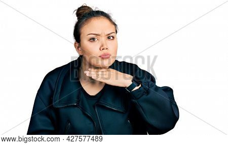 Young hispanic girl wearing sportswear cutting throat with hand as knife, threaten aggression with furious violence