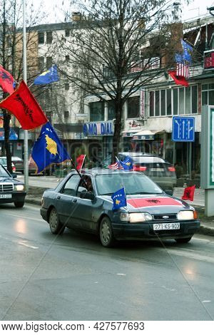 Prishtina, Kosovo - February 17, 2010: Car Passing By With Movement Blur, Wearing Flags Of Kosovo  A