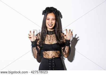 Sassy Beautiful Asian Woman In Black Lace Dress And Wreath Trying To Scare You, Raising Hands Up, Ac
