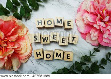 Home Sweet Home Alphabet Letter With Green Leave And Pink Flower Flat Lay On Marble Background