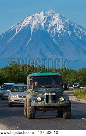 Old Soviet Off-road Vehicle Driving On Asphalt Road On Background Summer Landscape, Travel Destinati