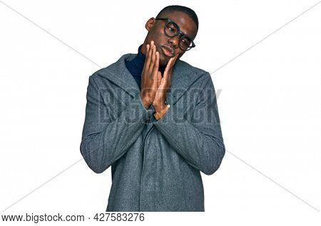 Young african american man wearing business clothes and glasses tired hands covering face, depression and sadness, upset and irritated for problem