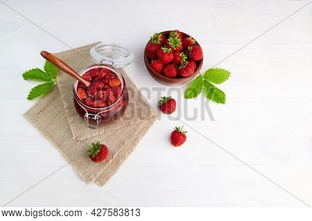 Homemade Strawberry Jam In A Glass Jar On A Linen Napkin. Fresh Strawberries In A Ceramic Bowl. Cons