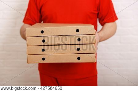 Pizza Delivery Boy Holding Boxes. Fastest Pizza Delivery In City. Man Holding Several Pizza Boxes. P