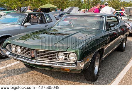 Homestead, Pennsylvania, Usa July 21, 2021 A Vintage Green Ford Gran Torino Car At A Summer Vintage
