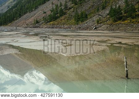 Scenic Alpine Landscape With Beautiful Shallow Mirror Mountain Lake With Reflection Of Snowy Mountai
