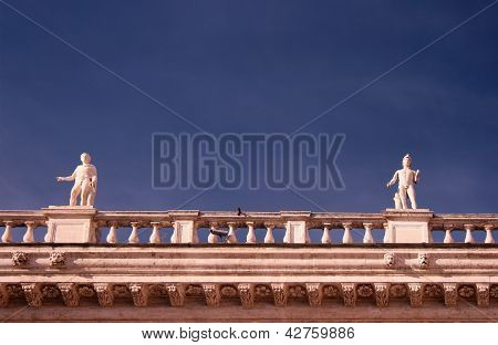 Marble Statues On Blue Sky Background