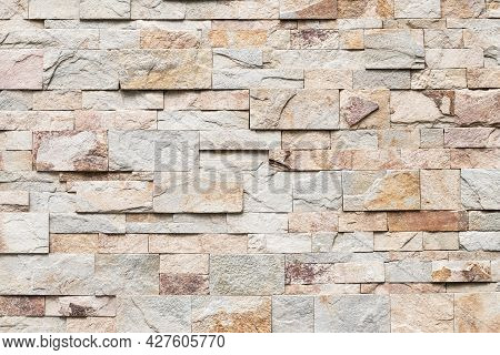 Old Brick Wall Texture, Abstract Stone Background. Urban Brickwall, Uneven Rough Stonewall. Beige Ti