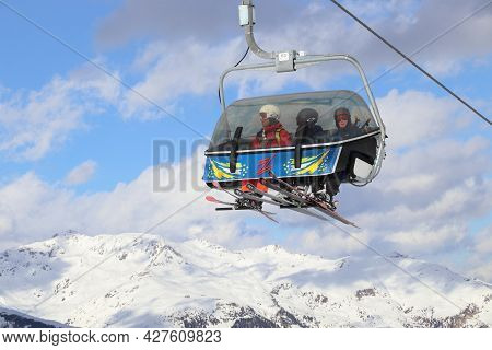 Hintertux, Austria - March 10, 2019: People Ride A Chairlift At Hintertux Glacier Ski Resort In Tyro