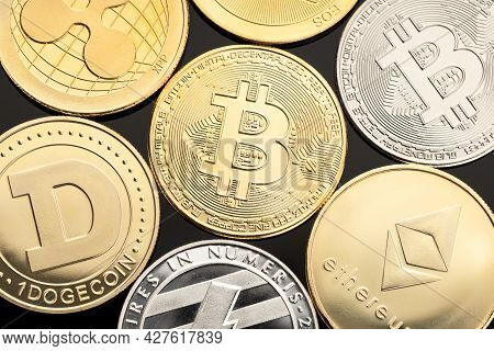 Group Of Cryptocurrency Coin On Black Background. Bitcoin, Dogecoin, Ethereum, Xrp, Eos, Litecoin Bl