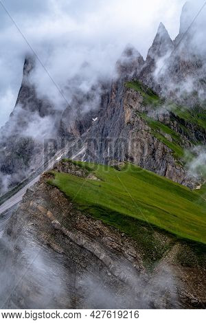 Hiking To The Peaks Of Seceda. Misty Summer Landscape In South Tyrol In The Alps Of Italy.