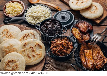 Table Served With Venezuelan Breakfast, Arepas With Different Types Of Fillings Such As Black Beans,