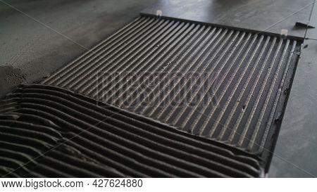 Dark Tiles On The Floor, Installation Process. Ceramic Tiles. Tiler Placing Ceramic Wall Tile In Pos