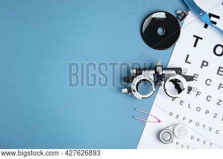 Different Ophthalmologist Tools On Light Blue Background, Flat Lay. Space For Text