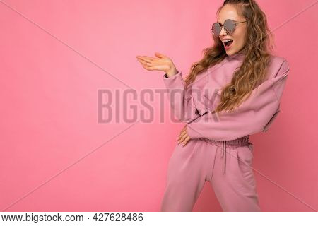 Attractive Happy Surprised Young Blonde Woman Wearing Everyday Stylish Clothes And Modern Sunglasses