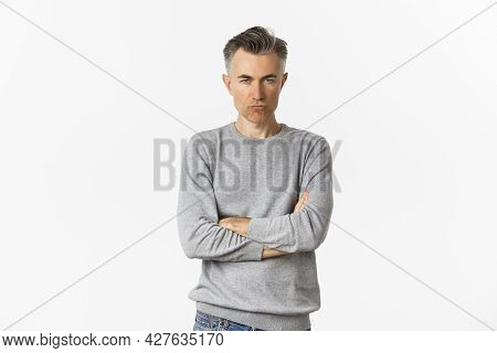 Image Of Angry Middle-aged Man Feeling Offended, Cross Arms On Chest And Squinting At Camera, Standi