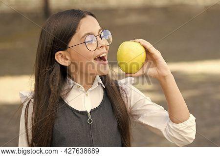 Healthy Dose Of Vitamin C. Happy Kid Eat Apple Outdoors. School Snack. Vitamin Nutrition. Health Edu