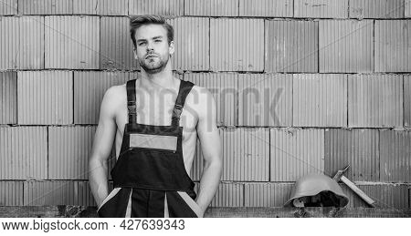 Handsome Man Wear Overalls. Break For Relax. Sexy Laborer. Attractive Worker. Construction. Worker B