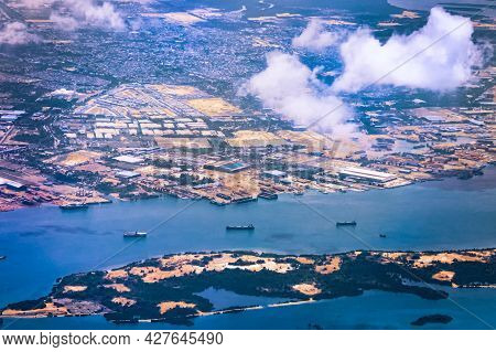 Aerial View Of Coastal Construction Or Port Areas In Strait Of Malacca, On Airplane Route To Malaysi