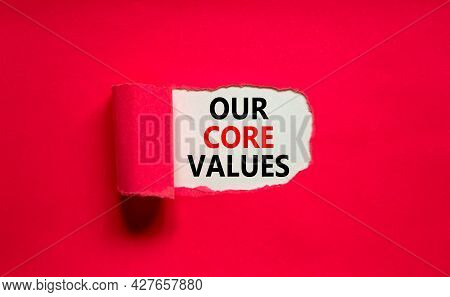 Our Core Values Symbol. Words 'our Core Values' Appearing Behind Torn Purple Paper. Beautiful Purple