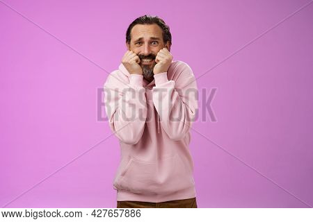 Scared Insecure Silly Adult Bearded Man Grey Hair In Pink Hoodie Press Palms Mouth Bite Fingers Clen