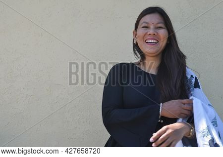 Waist Up Shot Of A South Asian Young Girl Smiling With Wearing Black Kurta (indian Traditional Dress