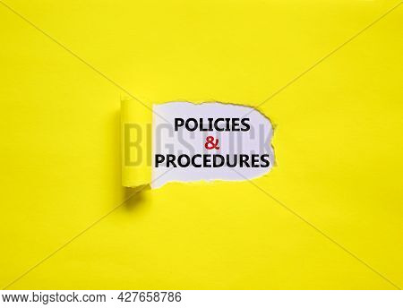 Policies And Procedures Symbol. Words 'policies And Procedures' Appearing Behind Torn Yellow Paper.