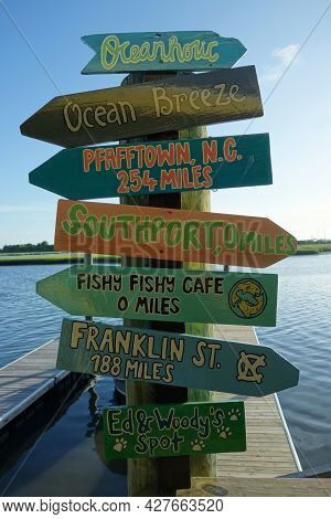 Southport,nc/usa - 06-29-2021: Colorful Direction Signs Outside Of Fishy Fishy Cafe In Southport Nor