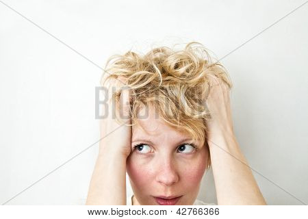 Blond Girl Pulling Hairs and looking left