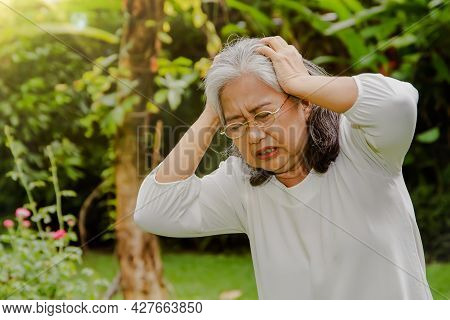 Elderly Asian Woman In Her 60's Had A Severe Headache Exacerbated Her Hand In Pain, Was Suffering Fr