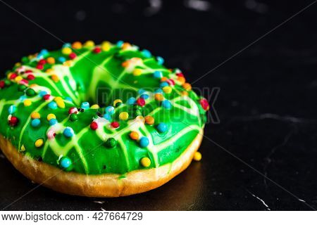 Green Glazed Donut With Sprinkles Isolated. Close Up Of Colorful Donut.