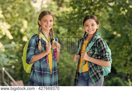 Progressive Pupils. Girls With School Bags. Child With Backpack. Happy Time. Fashion Little Girls Wi