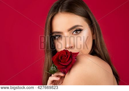 Woman With Red Rose On Red Background. Lips With Lipstick Closeup. Beautiful Woman Lips With Rose.