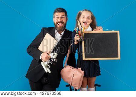 Funny Little Schoolgirl In School Uniform Having Fun In Studio. Portrait Of Amazed Excited Happy Pup