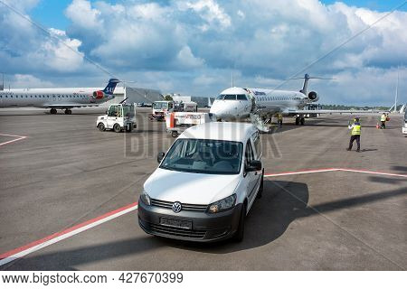 Munich, Germany - September 15, 2018: A Ground Crew And A Aviaton Marshall Supervisor Meeting A Big