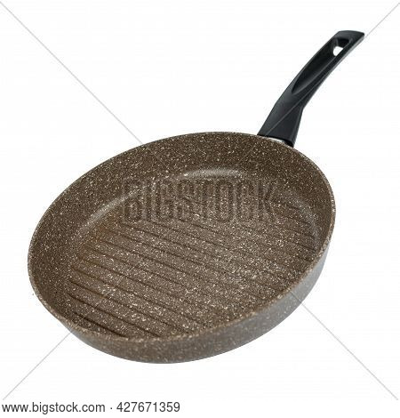 Brown Grill Pan With Ceramic Coating. Corrugated Surface Inside. A Frying Pan With A Black Handle.