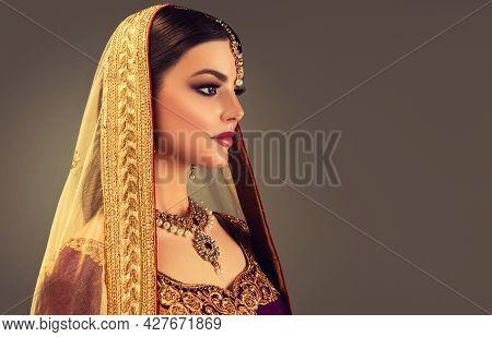 Portrait Of Beautiful Indian Girl. Young India Woman Model With Kundan Jewelry Set. Traditional Indi
