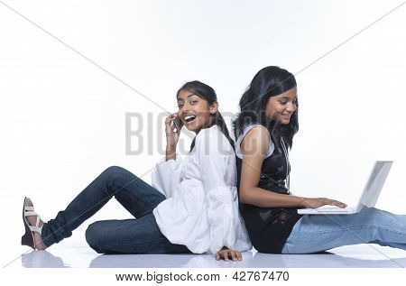girls with mobile and laptop