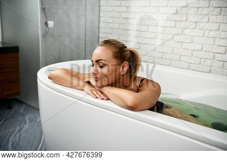 Pretty Young Woman Relaxes With Closed Eyes While Receiving Wellness Procedures In Spa Wellness Caps