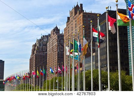 United Nations Headquarters with flags of the members poster