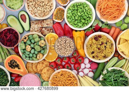 Vegan healthy food for vitality and fitness with plant based foods high in protein, fibre, antioxidants, anthocyanins, vitamins, minerals, omega 3, smart carbs and lycopene. Immune boosting concept.