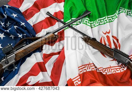 Flags Of Iran And Usa With Crossed Guns