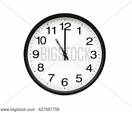What Time Is It. At 11 O'clock On The Round Clock White Background With Clipping Path