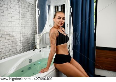 Attractive Young Woman Getting Ready For Spa Beauty Treatment In Spa Capsule. Hydro And Vibromassage