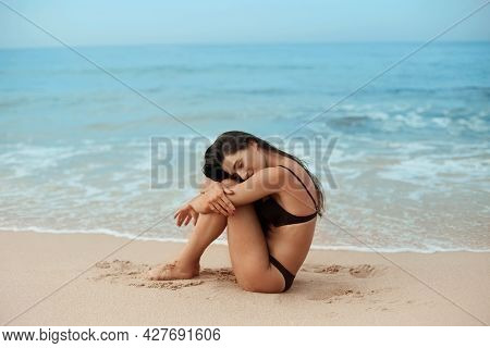 Beautiful Woman In Swimwear With Copy Space On The Beach. Portrait Of Pretty Girl With Slim Tanned S