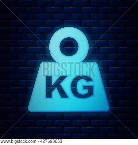 Glowing Neon Weight Icon Isolated On Brick Wall Background. Kilogram Weight Block For Weight Lifting