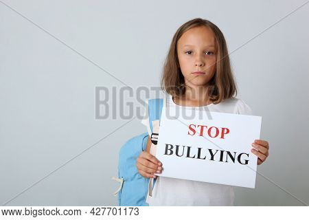 Sad Girl Holding A Stop Bullying Sign