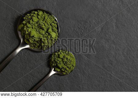 Chlorella Or Spirulina Powder In Spoons On A Dark Background. Green Algae Powder. Organic Mineral Su