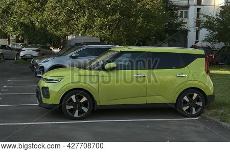 Moscow, Russia - July 20 2021: A Green Kia Soul Car Is Parked On The Street. Side View. The Whole Ca